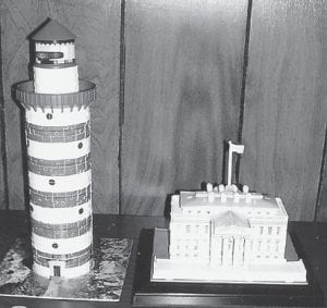 Lizze Mae Wright of Mayking worked these 3-D puzzles and brought them to the Ermine Senior Citizens Center. The puzzles form a lighthouse and the White House.