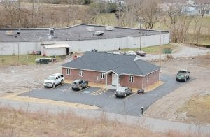 — The Letcher County Conservation District has moved into its new headquarters near the entrance to the Whitesburg Industrial Site, located behind the Whitesburg Plaza Shopping Center in West Whitesburg. A open house marking the new home is expected to be held soon. See story inside. (Photo by Sally Barto)