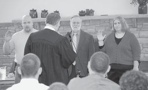 """Letcher Circuit Judge Sam Wright administered the oath of office to Letcher County Board of Education members Robert Kiser, William Smith, and Melinda """"Mendy"""" Boggs at the beginning of a special meeting last week."""