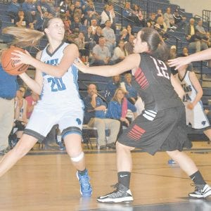 BIG WIN — Letcher County Central forward Julie Cornett looked to pass the ball during the Lady Cougars' victory over Harlan County. (Photo by Brandon Meyer/B. Meyer Images)