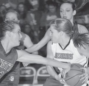 STAR OF THE GAME(S) — Knott County Central players surrounded Lady Cavalier Whitney Creech on January 15 during the Lady Patriots' 65-50 win over Jenkins in the All 'A' Classic Tournament district play. Creech led her team with 19 points, then came back six days later to score 34 points in another Jenkins loss to Knott Central, the latter one by a score of 62-50. (Photo by Brandon Meyer/B. Meyer Images)