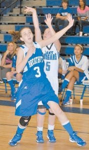 Breathitt County's Megan Stamper and Letcher County Central's Cheyenne Stidham (5) appeared to be going separate ways as Stidham fires a shot during the Lady Cougars win last week. Stidham scored 10 points. (Photo by Brandon Meyer/B. Meyer Images)