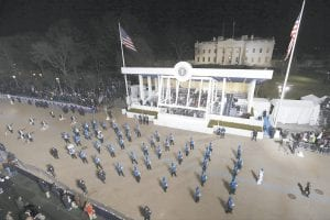 The Letcher County Central Marching Band passes by President Obama's viewing stand. The White House is in the background. (AP Photo/Chariie Neibergall)