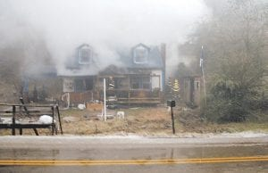— An elderly Thornton woman died of smoke inhalation after fire swept through the home she shared with her son during wet and icy conditions on January 25. Authorities believe the fire started in an electric water heater in the rear of the house. See story inside. (Photo courtesy Neil Lucas)