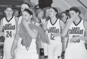 THEIR JOB IS DONE — Letcher County Central's Kelah Eldridge (24), Cheyanne Stidham, Vannah Breeding (45), Kristina Bentley (12), and Julie Cornett (20) leave the court after defeating 14th Region rival Perry County Central at Ermine, 58-49, on January 23. (Photo by Brandon Meyer/B. Meyer Images)