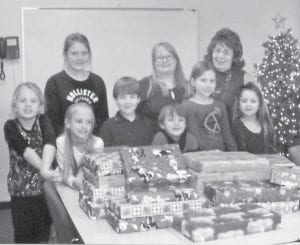 Shirley Sexton, with the help of West Whitesburg Elementary School staff and granddaughter Grayson Holbrook, delivered 29 pairs of pajamas to Letcher County foster care children. Pictured are (front) Mia Rouse, Kenzley Haley, Gunner Miles, Gage Rouse, Lauren Boggs, Kassondra Miles, (back) Taylor Boggs, Grayson Holbrook and Shirley Sexton.