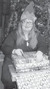 Grayson Holbrook sorted gifts given to Letcher County foster care children by her grandmother, Shirley Sexton.