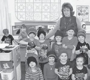 Shirley B. Sexton is pictured with some of the Jenkins Head Start students to whom she gave toboggans and gloves. The students are Chesnee Mason, Brady Swindall, Tucker Sexton, Xavier Robinson, Cody Reyes, Zachary Whitaker, Sophia Griffin, Luke Damron, Zoey Billiter, Kynlea Meade, Kinzleigh Damron and Hannah Cornett.