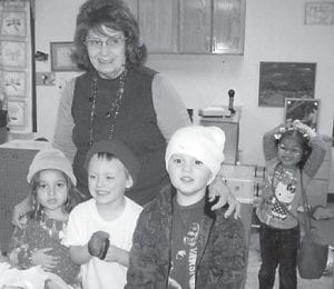 Erin Sexton, Haley Adams, Katie Kincer, Traistine White and Kevin Slone are pictured with Shirley B. Sexton, who gave the Head Start students toboggans and gloves.