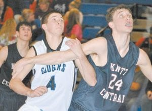 A FIGHT FOR POSITION — Letcher County Central forward Max Hall (4) battled for rebounding position with Knott Central forward Evan Hall (24) during the Patriots' win over the Cougars in a 53rd District game at Ermine. (Photo by Brandon Meyer/B. Meyer Images)