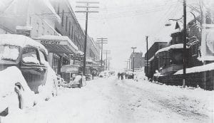These photographs, apparently taken in the late 1930's, show a couple of different views of downtown Whitesburg after heavy snowfall. The photo at top was taken by late Whitesburg barber Milburn Polly from East Main Street. The photo at bottom was taken at the corner of Webb Avenue and West Main Street and shows a lot that was occupied for many years by service stations before the expansion of what is now the Community Trust Bank building.