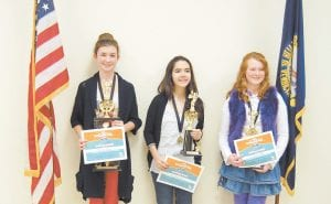 — Brooke Saurer (left), a seventh-grade student at Whitesburg Middle school, won the Letcher County Spelling Bee on February 8 and will return to state competition. Kirsten Sexton (center), an eighth-grade student at Arlie Boggs Elmentary School placed second. Darhla Miles, a seventh-grade student at Letcher Middle School finished third. Saurer will represent Letcher County at the Kentucky Derby Festival Spelling Bee on March 9 at the PNC Club at Papa John's Cardinal Stadium in Louisville. Saurer was a fourth-grade student the first time she competed in the state spelling bee. She is the daughter of James and Valerie Saurer of Partridge.