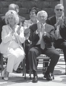 Letcher Schools Supt. Anna Craft sat with Gov. Steve Beshear in a ceremony held in April 2012 to mark the opening of the new Letcher County Area Technology Center. Craft will leave her job June 30.