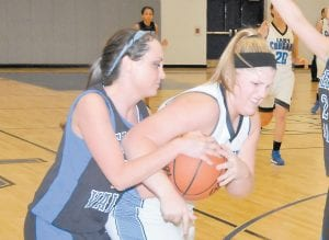 Letcher County Central's Vannah Breeding (right) battled between defenders Monday night during the Lady Cougars' win over 15th Region favorite Shelby Valley High School. (Photo by Chris Anderson)