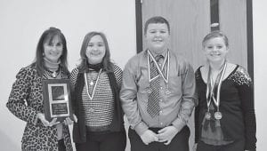MEDAL WINNERS — Pictured are the Whitesburg Middle School speech team medal winners at the regional tournament with their coach Coach Debi Sexton, who is holding the plaque for WMS, the first place winner of the Appalachian Region of the Kentucky High School Speech League. Left to right are Courtney Whitaker, Dalton McCown and Kaitlyn Davis.