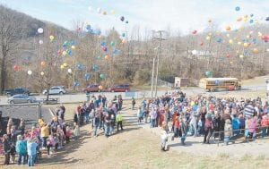 — Students at Letcher Elementary School and Letcher Middle School released balloons February 15 in memory of five-year-old Logan Howard, who died February 9 after running a batterypowered toy truck under a trampoline at Blackey. He was a kindergarten student at Letcher Elementary School. Several of Logan's family members attended the event. (Photo by Sally Barto)