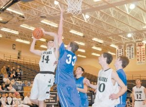 Jenkins forward Koty Sexton went up for a shot in the Cavaliers' 62-52 win over June Buchanan in the opening round of the 53rd District Tournament at Knott County Central on Monday. Sexton led all scorers in the game, dropping in 23 points in the winning effort. (Photo by Chris Anderson)