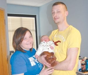 Logan Allen Wilder is the 100th baby delivered by Whitesburg Women's Center since it opened last fall. Logan was born February 21 at Whitesburg ARH, where the Women's Center is based. He weighed eight pounds, two ounces. He was 20 inches long. Logan is pictured with his parents, Emily Belcher Wilder and Landon Allen Wilder of Crases Branch. He was delivered by Crystal Gibson, PA-C. (Photo by Sally Barto)