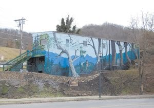 """The mural entitled """"Daniel Boone on the North Fork of the Kentucky River circa 1767"""" overlooks Main Street at the foot of Cowan Street (School Hill)."""