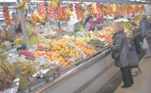 A woman buys fruit at a market in Barcelona, Spain. Mediterranean diets have long been touted as heart-healthy, but that's based on observational studies. Now, one of the longest and most scientific tests suggests this style of eating can cut the chance of suffering heart-related problems, especially strokes, in older people at high risk of them. (AP Photo)