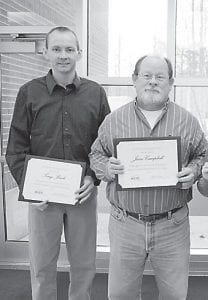 Hazard Community and Technical College recently honored associate professors Tony Back (left) of Premium and Jesse Campbell of Cornettsville for their 10 years of service at the school.