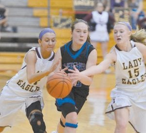 Letcher County Central's Emily Blair (center) fought with Leslie County's Victoria Boggs (left) and Katelyn Fee for control of the ball in Monday's 14th Region semifinal. (Photo by Brandon Meyer/B. Meyer Images)
