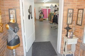 The entrance to Annie's Frugal Finery is shown in this photo. The first floor contains women's, men's, and children's clothing and other items. Three changing rooms are also located here.