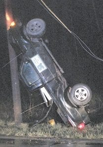 POLE(AR) OPPOSITES — This pickup came to a rest against a utility pole after the driver lost control Monday night. (Photo by Courtney Vaughn)