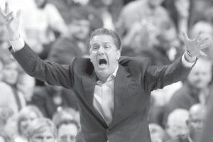 Kentucky head coach John Calipari reacted to a call during the second half of the Wildcats' 61- 57 upset over Florida at Rupp Arena in Lexington Saturday. (AP Photo/James Crisp)