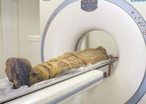 This photo released by a group of cardiologists led by Saint Luke's Mid America Heart Institute in Kansas City shows the mummy Hatiay (New Kingdom, 18th Dynasty, 1550 to 1295 BC) being scanned in Cairo, Egypt, where it was found to have evidence of extensive vascular disease by CT scanning. (AP Photo)
