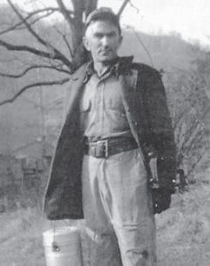 """The late Bill Howard, father of 14 children, is pictured in the 1950s going to work in the mines. His daughter, Whitesburg correspondent Oma Hatton, says, """"He had to walk to work to the top of the mountain carrying his water and food. He never complained. He was a Pentecostal preacher for over 40 years. Best daddy in the world! He passed away at 83 years. Twelve of his children survive, Oma, Louise, Kathleen, Betty, Hubert, John, Jack, Charles, Joanne, Hillard, Judy and Bob."""""""