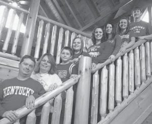 — Archie and Tiffany Hamilton of Craft's Colly, were married March 2 at Bear Foot Memories Cabin in Gatlinburg, Tenn. Pictured are (left to right) Archie Hamilton, Tiffany Hamilton, Matthew Hamilton, Cheyenne Bowling, Leighann Hall, Rachel Hamilton, Sarah Tackett and Michael Hamilton.