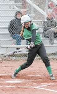 Alexis Stambaugh takes aim on a ball she hit for a solo homer against Harlan Independent.