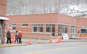 NEW LIBRARY ALMOST FINISHED — Jenay Hall, librarian of the Lillian Webb Memorial Library in Fleming-Neon, Letcher County Public Library District Director Angelina Tidal and Letcher County Library Board President Jeanette Ladd left the Fleming-Neon Public Library on March 26 after they checked the construction progress. One of the construction workers said painting on the inside walls will begin soon. A grand opening of the library is expected in mid-June. (Photo by Sally Barto)