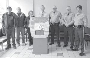 A medication dropbox is located in the Letcher County Sheriff 's Department. Letcher County Sheriff Webb said the dropbox is a safe way to dispose of old or unwanted prescription medications. A dropbox is also located at Jenkins City Hall. Pictured are Raymond Brown, Letcher County Health Department Coordinator Matthew Combs, Jill Hatch, Operation UNITE Vice President Dan Smoot, Letcher County Sheriff Danny Webb, Deputy Bert Slone and Deputy Valerie Breeding. Brown, Combs and Hatch are members of the United Substance Abuse Prevention (USAP) council of Letcher County.