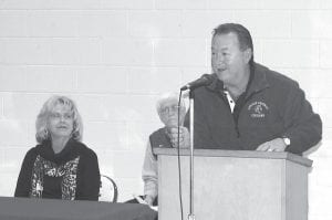 New Letcher County Central football coach Mike Holcomb (right) was introduced to the public on March 20 during an event at the school. Also pictured are Supt. Anna Craft and Athletics Director Ozz Jackson.