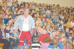 Professional wrestler Rock-n-Roll Marty Gibson entertained students at Cowan Elementary School last week while spreading his anti-drug message. Gibson will appear at Letcher Elementary in April.