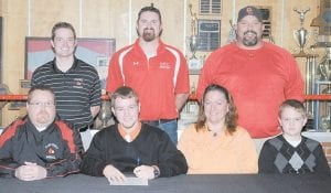 Jesse Bates, a senior at George Rogers Clark High School in Winchester, has signed a letter of intent to play baseball at the University of Pikeville. Jesse is pictured with his parents, Morris and Tracy Bates, his brother Dustin Bates and (back row left to right) Clark County Athletic Director Ryan Nolan, GRC head baseball coach Matt Ginter, and his strength /conditioning coach Rick Mitchell. Jesse is the grandson of Jesse and Stella Bates of Whitesburg and Corene and the late Eddie Holbrook of Mayking. He is the great-grandson of Morris and Della Maggard of Cowan.