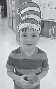 Drake Brown, a student at West Whitesburg Elementary School, earned a cupcake by donating food items to the Food Pantry.