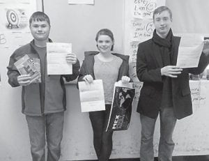 These Arlie Boggs Elementary School students show their responses from Mexico. Pictured are Jordan Jenkins, Anne Lewis and Charles Drake Hensley.