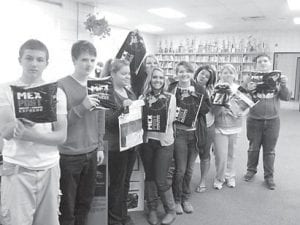 Whitesburg Middle School students display some of the items on Mexico they received via express mail. Pictured are Christian Broderdorp, Tannar Lucas, Elizabeth Haley, Alexis Collins, Kianna Day, Kara Collins, Sheila Cole, Cheyenne Proffit and Noah Griffin.