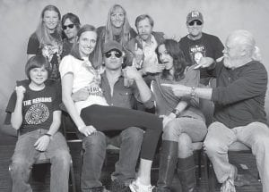 """The Banks family posed for a photograph with cast members from """"The Walking Dead"""". The family attended an event called HorrorHound Weekend held at the Sharonville Convention Center in Cincinnati, Ohio. Several other actors and authors attended including John Carpenter, """"Eddie"""" and """"Marilyn"""" from the original """"Munsters"""" cast, cast members from """"Christine"""" as well as the car, and Robert Patrick. From left to right (back row) are Haley Banks, Norman Reedus, Pam Banks, Lew Temple, Michael Rooker, (front row) Chandler Riggs, Nicole Banks, Jon Bernthal, Sarah Wayne Collins and Scott Wilson."""
