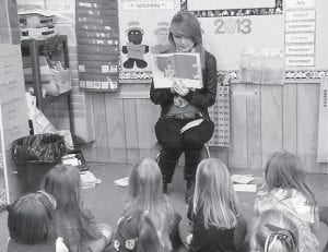 "The Interact Club of Jenkins Independent School celebrated Dr. Seuss's birthday by participating in the Read Across American program. The officers of the club read Dr. Seuss books, which include ""Green Eggs & Ham"" and ""The Cat in the Hat"", to kindergarten and first grade students at McRoberts and Burdine elementary schools, and left books with each class. Pictured is Kelly Adams, a junior at Jenkins High School, club treasurer, and the daughter of Danny and Brenda Adams. The Interact club does both community and international service projects and is sponsored by Barbara Ison and Margaret Hammonds through The Rotary Club of Whitesburg. The teacher sponsor is Angela Collins."