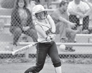 Jenkins Lady Cavalier Melissa Bartley connected bat with ball Monday. (Photo by Chris Anderson)
