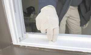 Lead risk assessor Tom Barsa swiped a windowsill for lead April 4 in Lakewood, Ohio. More than half a million U.S. children are now believed to have lead poisoning, roughly twice the previous high estimate, health officials report. (AP Photo)