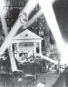 """Searchlights framed the """"Tara"""" facade of Loew's Grand Theater on Peachtree Street in Atlanta for the movie premiere of """"Gone With the Wind"""" on Dec. 15, 1939. Residents from Letcher County were among those trekking to Georgia to see the movie before it was released nationwide. (AP Photo)"""