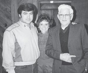Charles Howard, Judy Greene, and the late Bill Howard are pictured at a Christmas party in 1985.