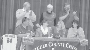 """Letcher County Central High School Lady Cougar Kelah Eldridge signed scholarship papers Tuesday afternoon to play basketball at the University of Pikeville. Eldridge is the Most Valuable Player of the 14th Regional Tournament. Pictured are (front row from left) Kelah Eldridge's father Kelvin Eldridge, Kelah Eldridge, UPike Women's Basketball Coach Joanna McNamee, Kelah Eldridge's mother Anita Eldridge, (back row) LCCHS Girls' Basketball Coach Dickie Adams, LCCHS Athletic Director Arthur """"Ozz"""" Jackson and LCCHS Principal Stephen Boggs. McNamee said she went to the Sweet Sixteen basketball tournament to watch Kelah Eldridge. """"Her work ethic is spot on,"""" said McNamee. Adams said Kelah Eldridge has the longest history in the United States of being on a high school basketball bench. Eldridge was a water girl for Adams when she was in the second grade."""