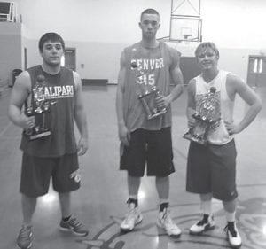 Josh Proffitt, Sam Sparkman and Steven Patrick are the winners of the Letcher County 3-on-3 Basketball Tournament. The 2013 champions of team Heat Check received the first-place trophy after a day of outstanding basketball.