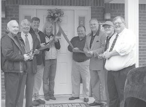— A ribbon-cutting ceremony was held April 19 at the new Letcher County Conservation District building in West Whitesburg. The1,800-square-foot building cost about $260,000 and was designed by Kenar Architectural Inc. of Frankfort. Cutting the ribbon were, from left, Whitesburg City Councilman James W. Bates, Mayor James W. Craft, Letcher County Judge/Executive Jim Ward, State Rep. Leslie Combs, Steve Coleman, former state director of the Division of Conservation, City Councilman Larry Everidge, Letcher County Conservation District Board Members Billy K. Banks and Ron Brunty.